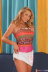 Big boobed blonde in pink top sheds white miniskirt and black thongs to