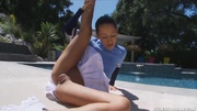 flexible brunette cheerleader demonstrates