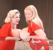 Two BBWs dressed in red making out with each other