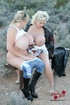 Blonde BBWs with saggy tits posing on a bench outdoors
