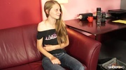 shy-looking blonde teen riding