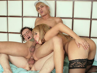 image Fiery brunette receives two boners in all of her holes