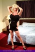 Smoking hot blonde granny teases with her foxy body in black dress and