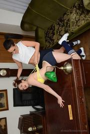 socks-wearing schoolgirls pulling each