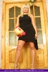 Blonde MILF teases with her alluring body in black dress and high heels
