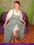 Hot granny pose her fat body in white blouse and multi colored dress then
