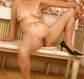 Steaming hot grandma shows her sweet breasts and old body then pulls down