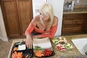 engaging blonde wearing orange