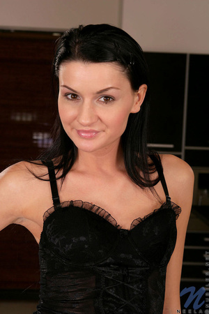 A brunette, with a tight body, smiles an - XXX Dessert - Picture 1