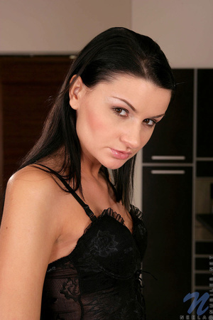 A brunette, with a tight body, smiles an - XXX Dessert - Picture 3