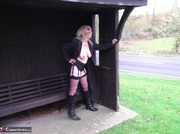 blonde wearing leather boots