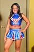 Black stunner in blue cheerleader outfit stripteasing and posing in tight