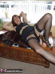 brunette milf black dress