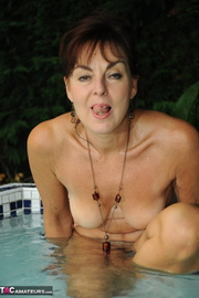 brunette milf goes naked