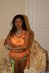 Orange outfit dressed indian with black hair exposing her tight thongs