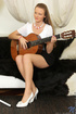 Young brunette slut in white and black dress plays her guitar before fingering