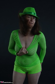 brunette milf green outfit