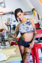 heavily tattooed brunette blue