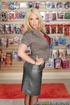 Blonde takes off her leather skirt and tight grey blouse