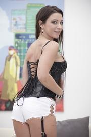 blue-eyed brunette corset takes