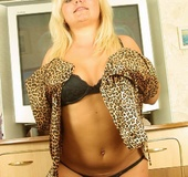 Luscious blonde teases with her banging body in black and brown leopard