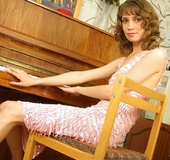 Gorgeous brunette teases with her skinny body in pink dress and brown