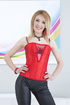 Glamorous blonde in black leather leggings and red lace bra plays with