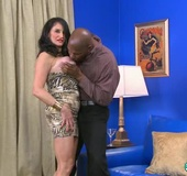 Dark haired granny with red lips and nails lets black guy lick her big