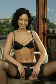 nylons-wearing brunette posing with