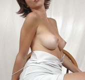 Hot MILF teases with her alluring body before she pulls down her white