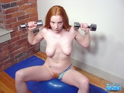 indulging redhead spreads wide