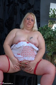 blonde granny teases with