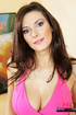 Brunette chick with brown eyes pulls down her pink dress and exposing