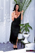 Black haired milf in long black dress and high heels teasing by the white