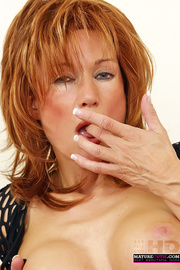 mature redhead black outfit