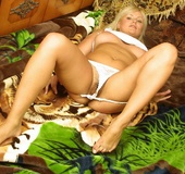 Busty blonde with pierced belly posing on the floor in white undies and