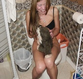Hairy cunt brunette in black bra peeing on the white toilet bowl and playing
