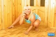 big boobed blonde posing