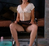 High heeled brunette in white shirt and dark miniskirt cuts her pussy