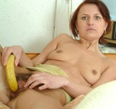Hairy pussy brunette in yellow miniskirt and white top undressing on the
