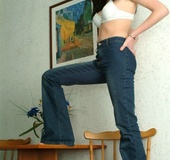 Black haired bimbo wiggles out of jeans and white undies just to expose