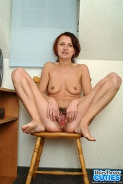 mature brunette with green
