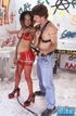 Pregnant ebony in red latex outfit and fishnet stockings blowing white