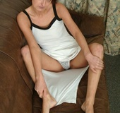 Small boobs redhead in white dress and underwear undressing on the brown