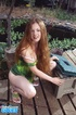 Long haired redhead wiggles out of green dress and white undies to expose