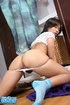Black haired asian in white top and thongs undressing on the floor before