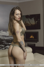 tattooed chick teases with