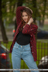 Brunette teen in jeans and red shirt posing outdoors before teasing naked
