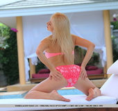 Pink bikini dressed blonde with big naturals and shaved fuck holes undressing