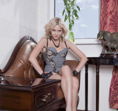 Foxy blonde teases with her alluring body in gray and black lingerie before